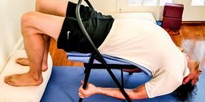 yoga-student-stretching-with-chair