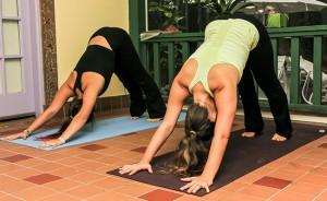 yoga-students-training-together-outside