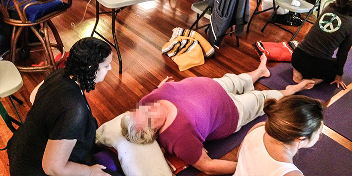 yoga-teacher-doing-therapy-on-student